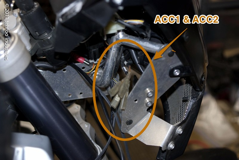 (unswitched) and acc2 (switched) wires in the ktm harness  this is the  right side of the headlight shroud, they were tucked up just behind the  subframe